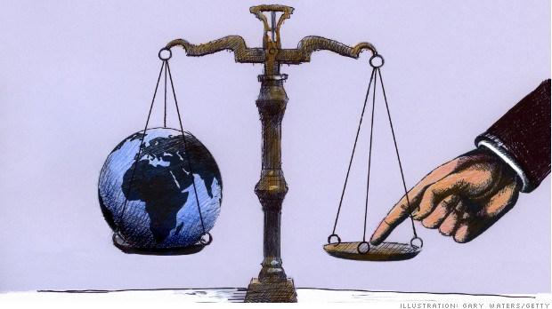 140127173656-global-inequality-scales-620xa