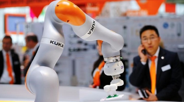 A robot arm of German industrial robot maker Kuka is pictured at the company's stand in Hanover